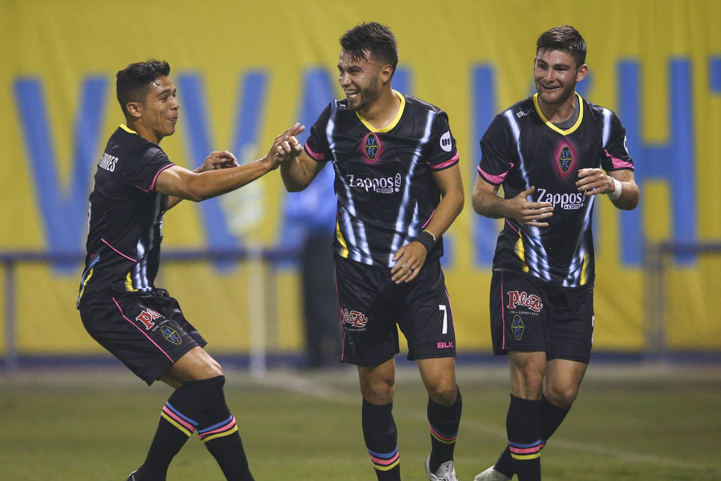 Las Vegas Lights FC midfielder Carlos Alvarez (7) celebrates his goal with defender Jorge Guillen-Torres, left, and midfielder Matt Thomas during the first half of a United Soccer League game agai ...