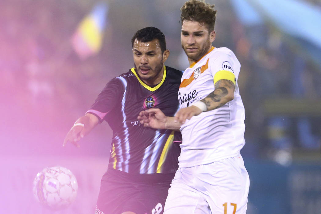 Las Vegas Lights FC forward Sammy Ochoa (left) goes for the ball against Tulsa Roughnecks FC defender Francisco Ugarte (17) during the first half of a United Soccer League game at Cashman Field in ...