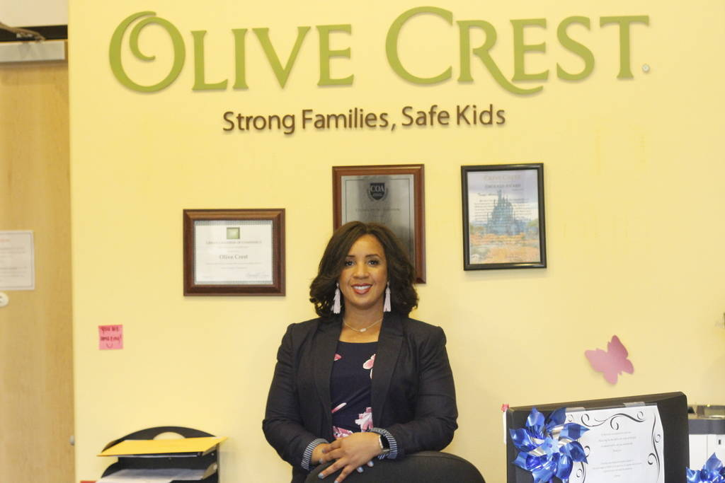 Myesha Wilson, executive director of Olive Crest, stands in the lobby of Olive Crest on Wednesday, April 27, 2018.