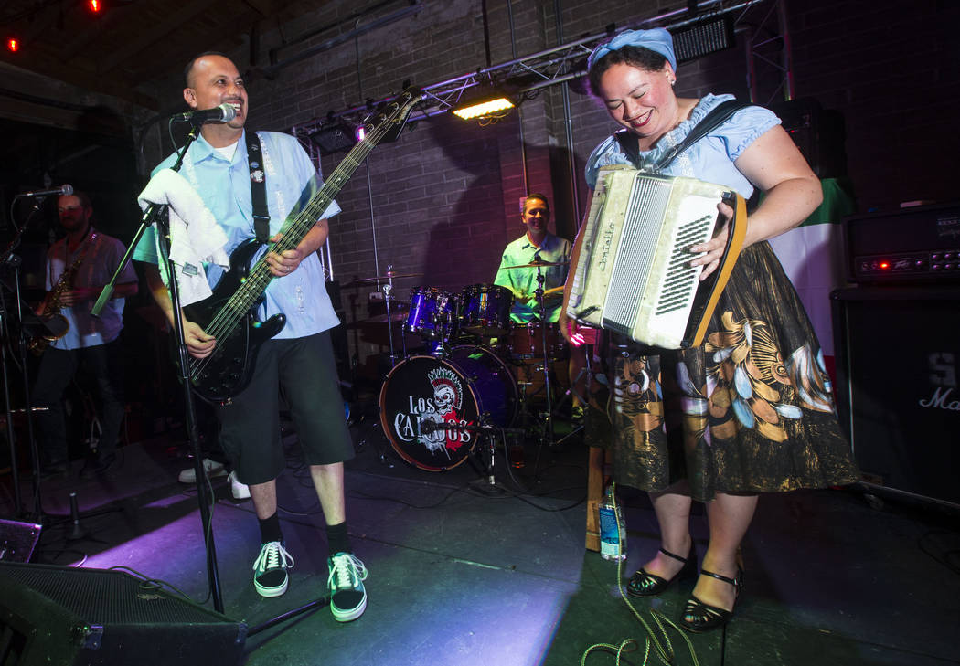 Los Carajos, singer-bassist John Fernandez Jr., drummer Rich Castro and accordionist Stephanie Geniza, performs at Cornish Pasty in downtown Las Vegas on Saturday, April 28, 2018. Chase Stevens La ...