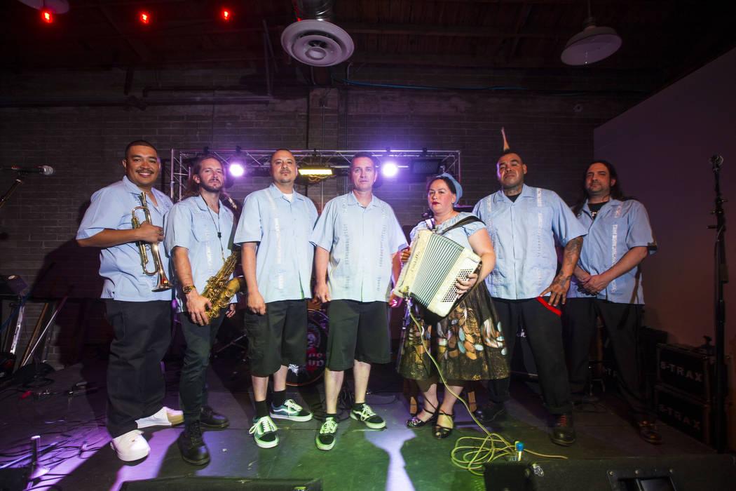 Members of Las Vegas band Los Carajos, from left, trumpeter Daniel Valdez, saxophonist Christopher Diasparra, singer-bassist John Fernandez Jr., drummer Rich Castro, accordionist Stephanie Geniza, ...