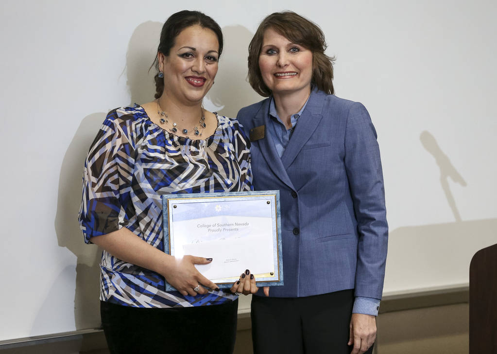 College of Southern Nevada business professor Jet Mitchell, right, presents business student Diana Moreno with the Outstanding Student Of The Year Award during CSN's Outstanding Student Award Cere ...