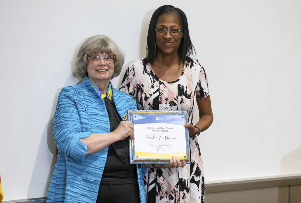 College of Southern Nevada nursing professor Deborah Ain, left, presents nursing student Sandra Spencer with the Outstanding Student Of The Year Award during CSN's Outstanding Student Award Ceremo ...