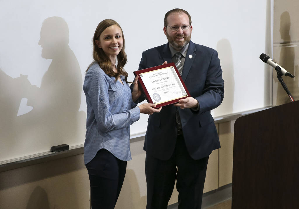 College of Southern Nevada student Lauryn Guerrissi, left, receives the Regents Scholar Award from the Board of Regents' Dr. Patrick Carter during CSN's Outstanding Student Award Ceremony at CSN's ...