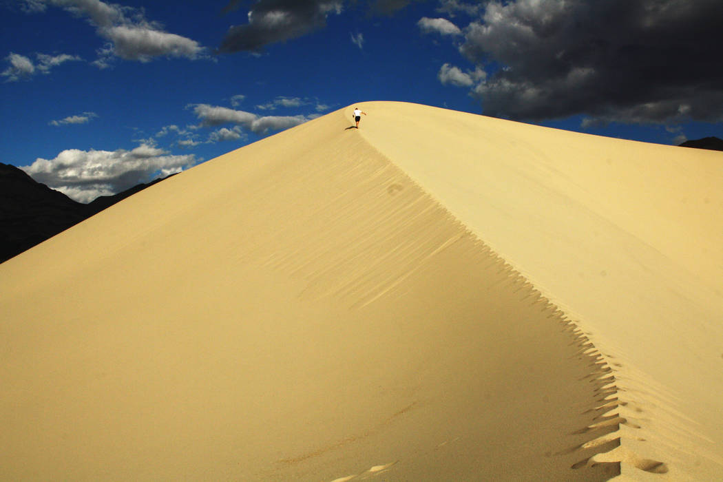 A hiker heads up a peak at Eureka Sand Dunes in Death Valley National Park, California. (Deborah Wall)