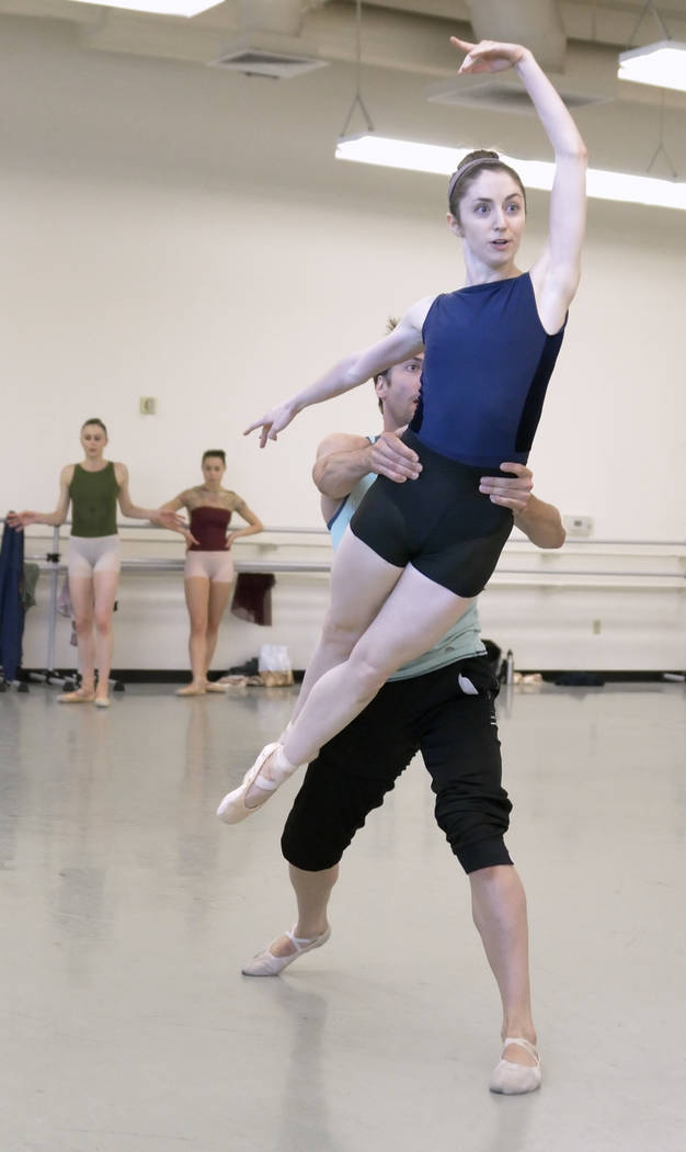 "Emma McGirr is lifted by Sergio Alvarez during a rehearsal for the world premier of choreographer Matthew Neenan's ""Until December"" at the Nevada Ballet Theatre studios at 165 ..."