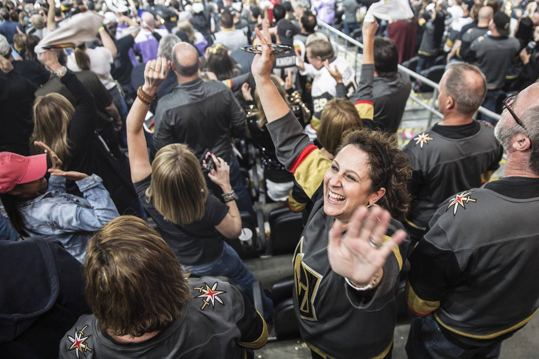 Fans celebrate after Vegas' Erik Haula scored a game tying goal in the third period during game two of their second round playoff series on Saturday, April 28, 2018, at T-Mobile Arena, in Las Vega ...