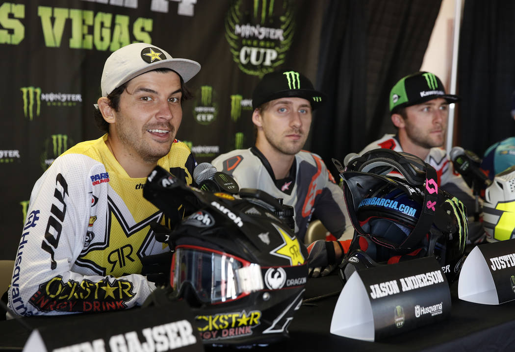 Jason Anderson, left, rider in the 2017 Monster Energy Cup Race, speaks during a press conference as Justin Barcia, center, and Marvin Musquin look on at Sam Boyd Stadium Friday, Oct. 13, 2017, in ...