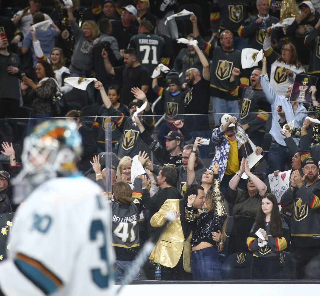 Golden Knights fans celebrate their win over the San Jose Sharks in Game 5 of an NHL hockey second-round playoff series at T Mobile Arena in Las Vegas on Friday