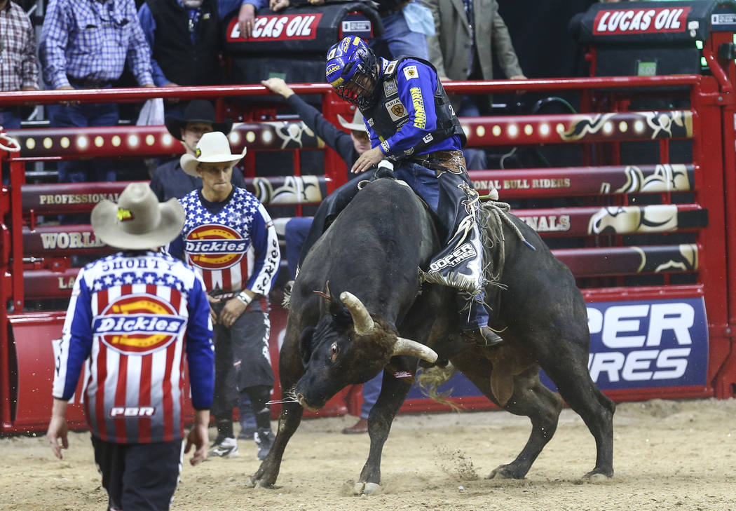 """Kaique Pacheco rides """"Organized Crime"""" while competing in the opening round of the Professional Bull Riders World Finals at the T-Mobile Arena in Las Vegas on Wednesday, Nov. 2, 2016. Ch ..."""