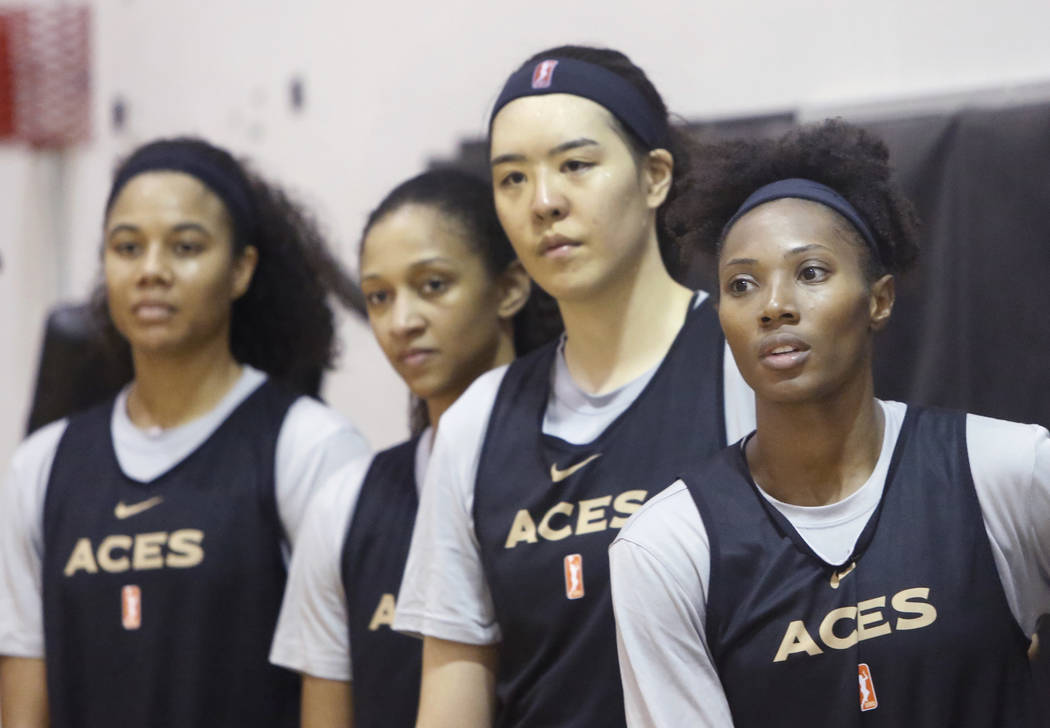 Las Vegas Aces players, including guard Sequoia Holmes, right, listen to their coach after team practice at UNLV's practice court on Tuesday, May 1, 2018, in Las Vegas. Bizuayehu Tesfaye/Las Vegas ...