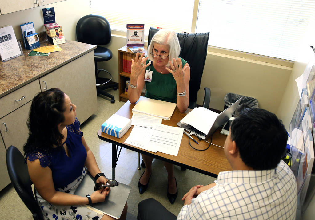Brenda Reardon, left, and her husband Mike listen as Barbara Caldwell, a nurse practitioner and cancer genetic counselor at Comprehensive Cancer Centers of Nevada, explains the benefit of testing ...