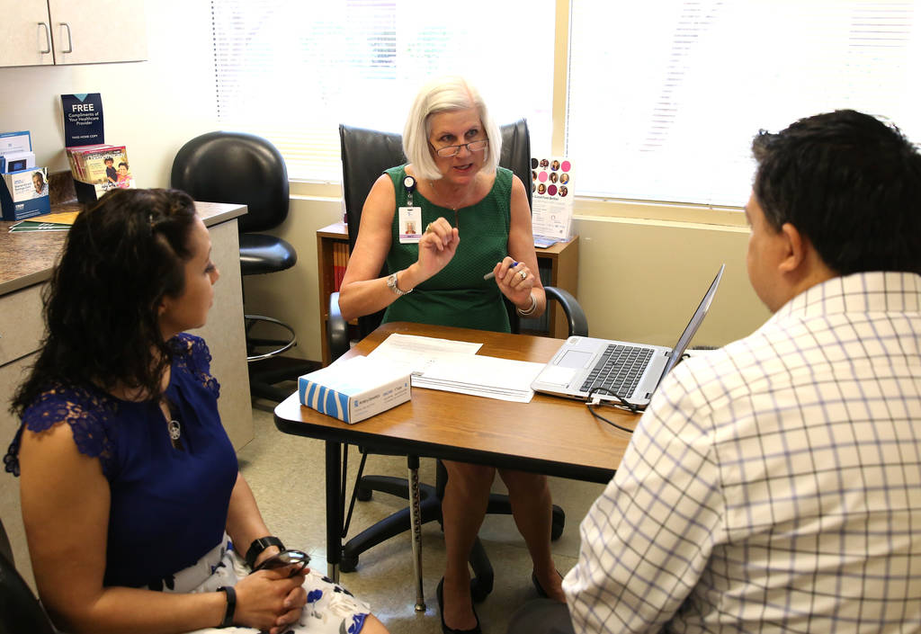 Brenda Reardon left, and her husband Mike listen as Barbara Caldwell, a nurse practitioner and cancer genetic counselor at Comprehensive Cancer Centers of Nevada, explains the benefit of testing f ...