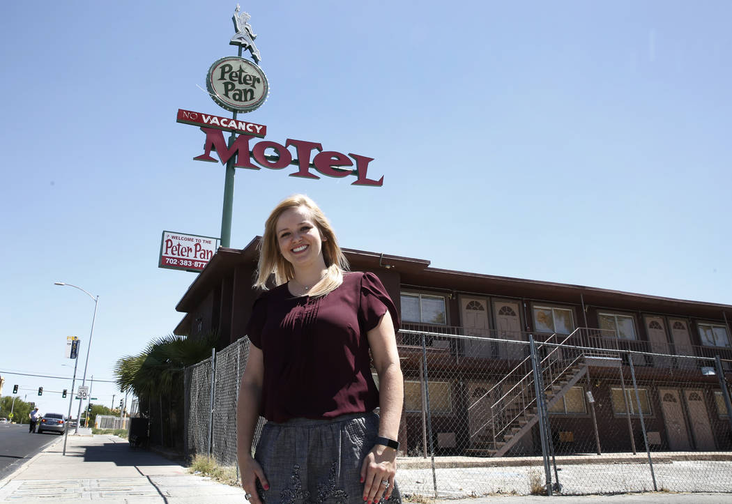 Shae Cox, deputy director of Preserve Nevada, poses for photo outside the boarded up Peter Pan Motel at 110 N. 13th St., on Wednesday, May 16, 2018, in Las Vegas. Bizuayehu Tesfaye/Las Vegas Revie ...