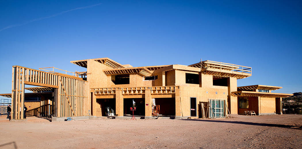 Construction is underway at the showcase home in the Estates at Reflection Bay in Lake Las Vegas. It is expected to open this fall. (Tonya Harvey)