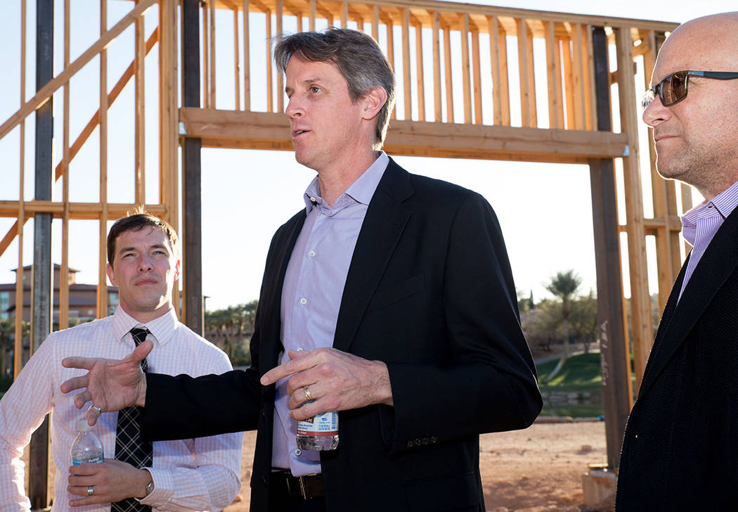 Architect Michael Wetzel, center, talks to and Kit Gallup, left, and Luxury Realtor Ivan Sher, right, about the showcase home under construction in Lake Las Vegas. (Tonya Harvey)
