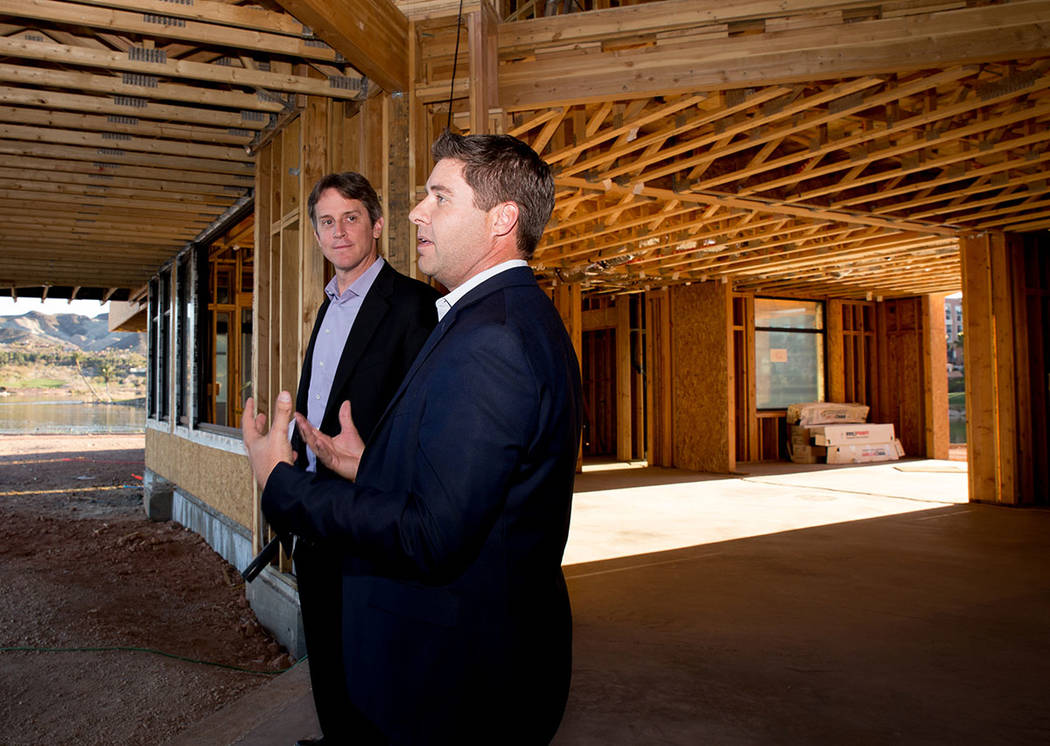 At right, Cody Winterton, Lake Las Vegas' senior vice president, talks to Michael Wetzel of Arizona-based Swaback Architects + Planners about the South Shore development. (Tonya Harvey)