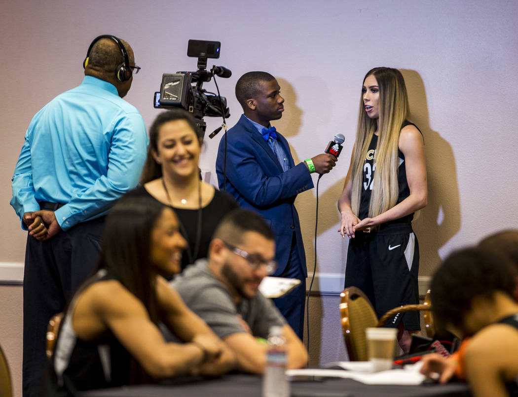 Former UNLV Lady Rebels player and Las Vegas Aces guard Brooke Johnson is interviewed by Power 88 radio station during the Las Vegas Aces media day at MGM Grand in Las Vegas on Thursday, May 3, 20 ...