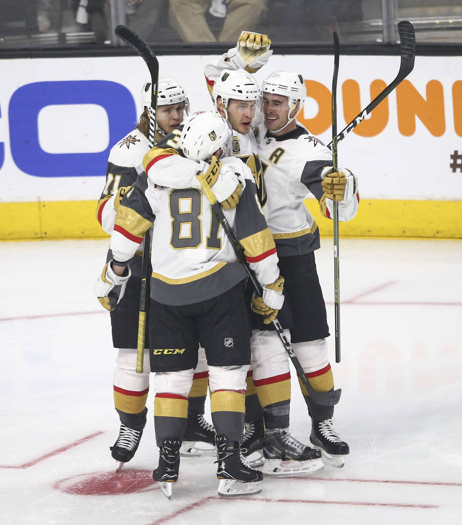 Golden Knights defenseman Brayden McNabb, third from left, celebrates his goal with center William Karlsson (71), center Jonathan Marchessault (81) and right wing Reilly Smith (19) during the seco ...