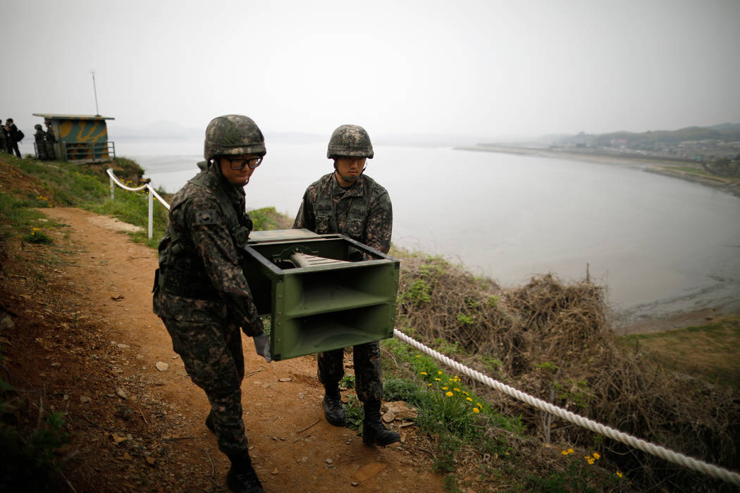 South Korean soldiers move loudspeakers that set up for propaganda broadcasts near the demilitarized zone separating the two Koreas in Paju, South Korea, Tuesday, May 1, 2018. The leaders of the ...