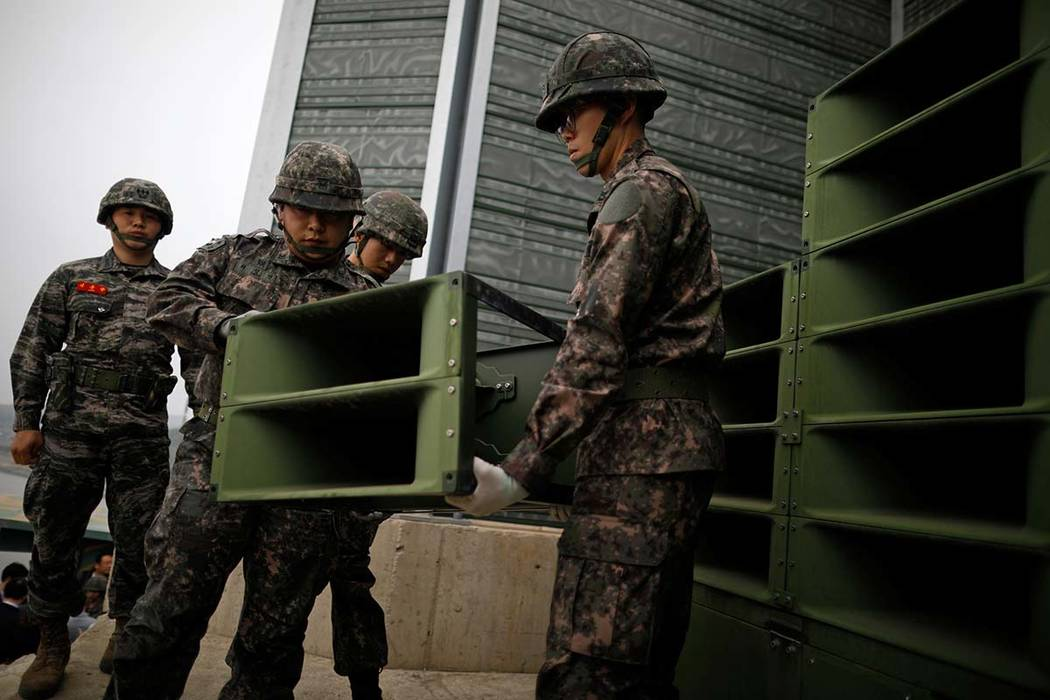 South Korean soldiers dismantle loudspeakers that used to broadcast propaganda near the Demilitarized Zone separating the two Koreas in Paju, South Korea, Tuesday, May 1, 2018. (Kim Hong-Ji/AP)