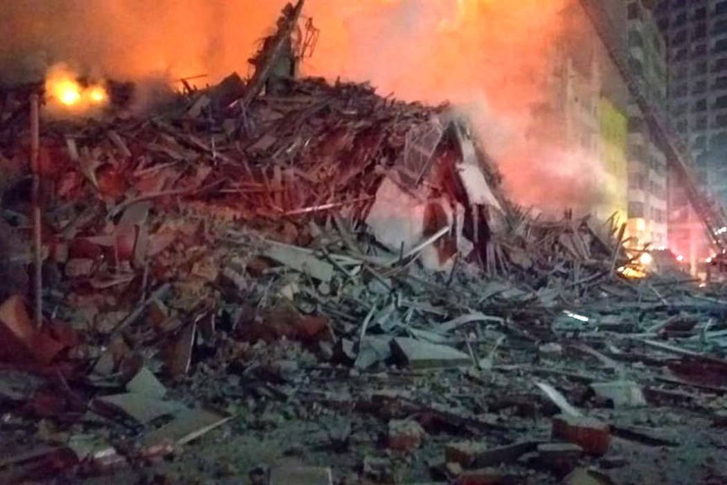 In this photo released by Sao Paulo Fire Department, debris of a building which was engulfed by a fire and collapsed, in Sao Paulo, Brazil, Tuesday, May 1, 2018. (Sao Paulo Fire Department via AP)