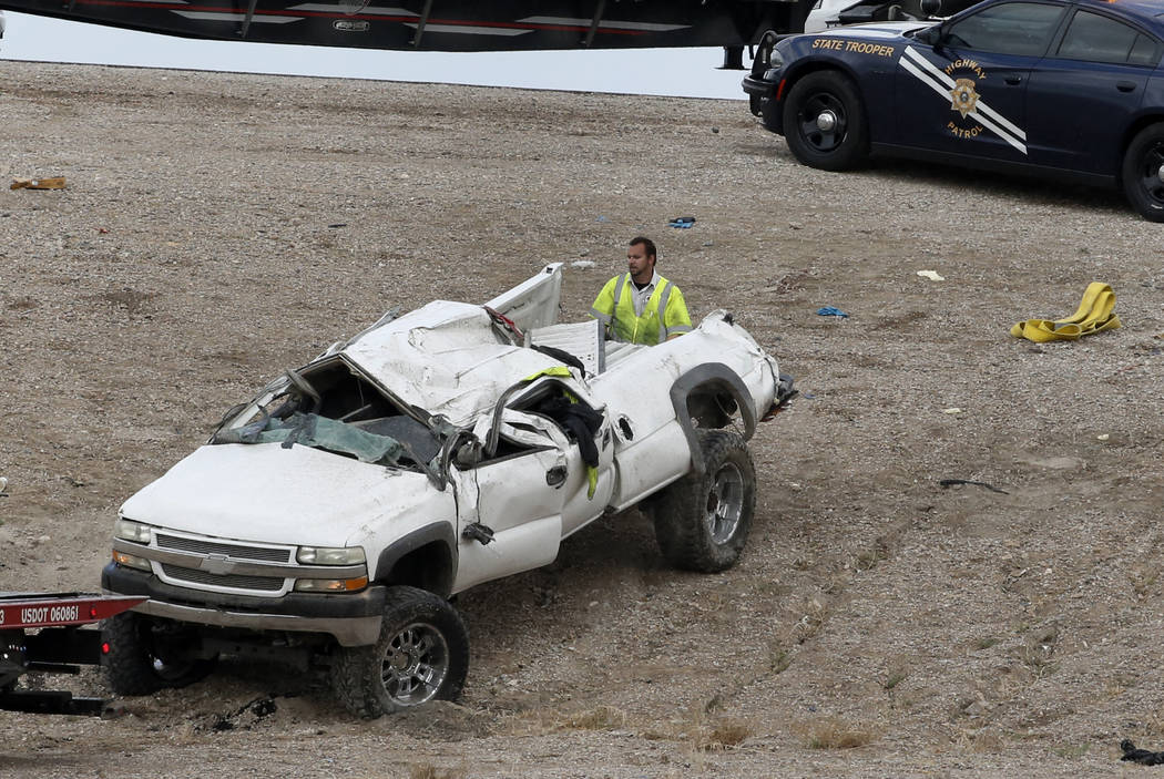 A tow truck driver prepares to tow a car involved in a fatal crash from the scene where a 48-year-old man was killed at the 215 Beltway and Losee Road in North Las Vegas on Tuesday, May 1, 2018. ( ...
