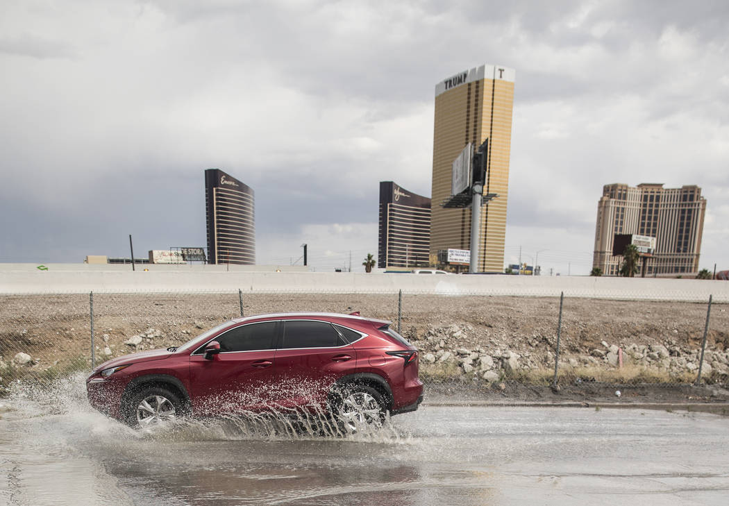 Cars drive through flooded streets on West Sirius Avenue and Rancho Drive on Tuesday, May 1, 2018, in Las Vegas. Benjamin Hager Las Vegas Review-Journal @benjaminhphoto