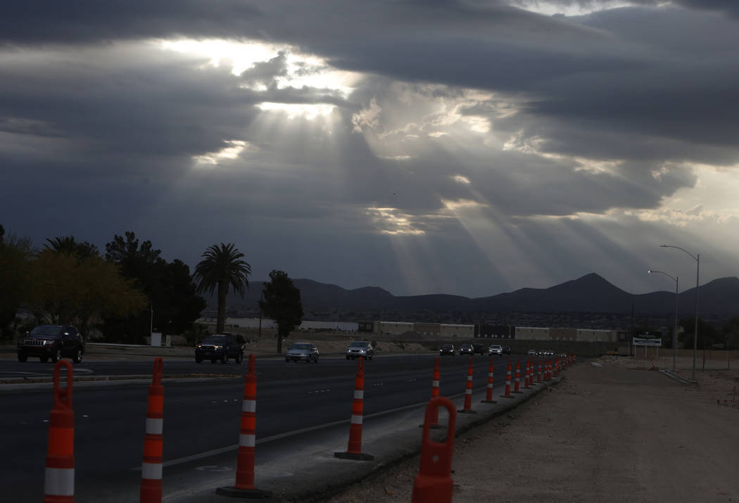 A shaft of light breaking through the dark clouds as seen from Volunteer Boulevard in Henderson Tuesday, May 1, 2018. Tuesday shows a forecast high of 69 degrees, breezes and a 40 percent chance o ...