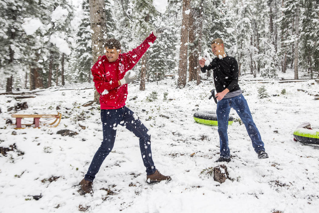 "Jeff Schneider, right, throws snow at his brother Zack Schneider near the Cathedral Rock trailhead at Mount Charleston on Tuesday, May 1, 2018. ""I heard my brother talking about the weather a ..."
