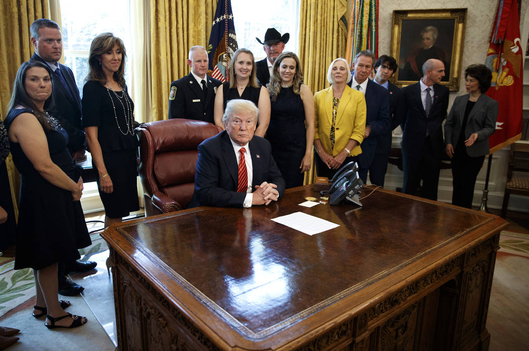 President Donald Trump pauses as he meets with crew and passengers of Southwest Airlines Flight 1380, including pilot Tammie Jo Shults, third from left, and Secretary of Transportation Elaine Chao ...