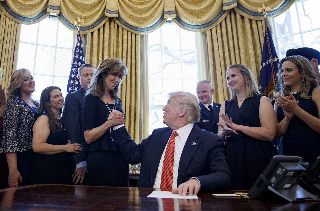 President Donald Trump shakes hands with pilot Tammie Jo Shults, as he meets with crew and passengers of Southwest Airlines Flight 1380 in the Oval Office of the White House in Washington, Tuesday ...