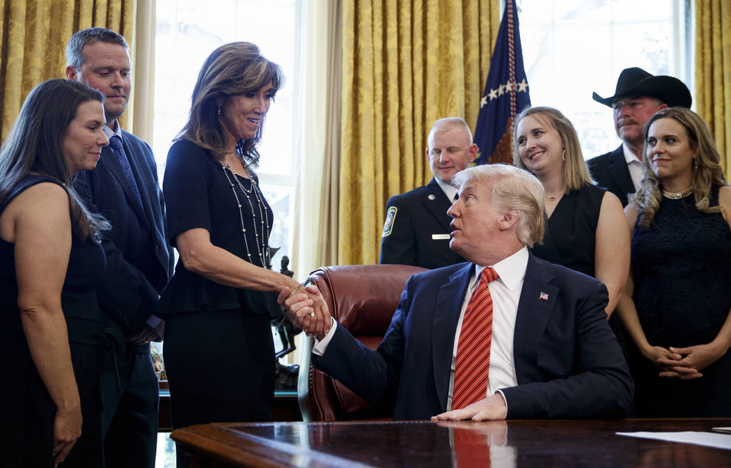 President Donald Trump shakes hands with pilot Tammie Jo Shults as he meets with crew and passengers of Southwest Airlines Flight 1380 in the Oval Office of the White House in Washington, Tuesday, ...