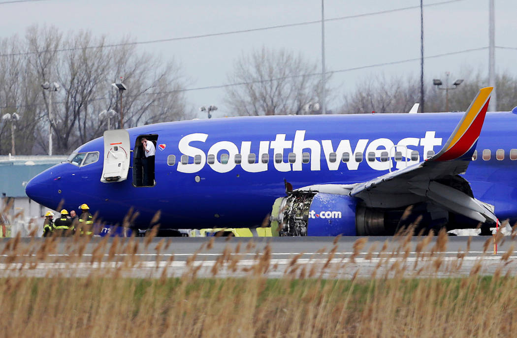 A Southwest Airlines plane sits on the runway at the Philadelphia International Airport after it made an emergency landing in Philadelphia, on Tuesday, April 17, 2018. (David Maialetti /The Philad ...