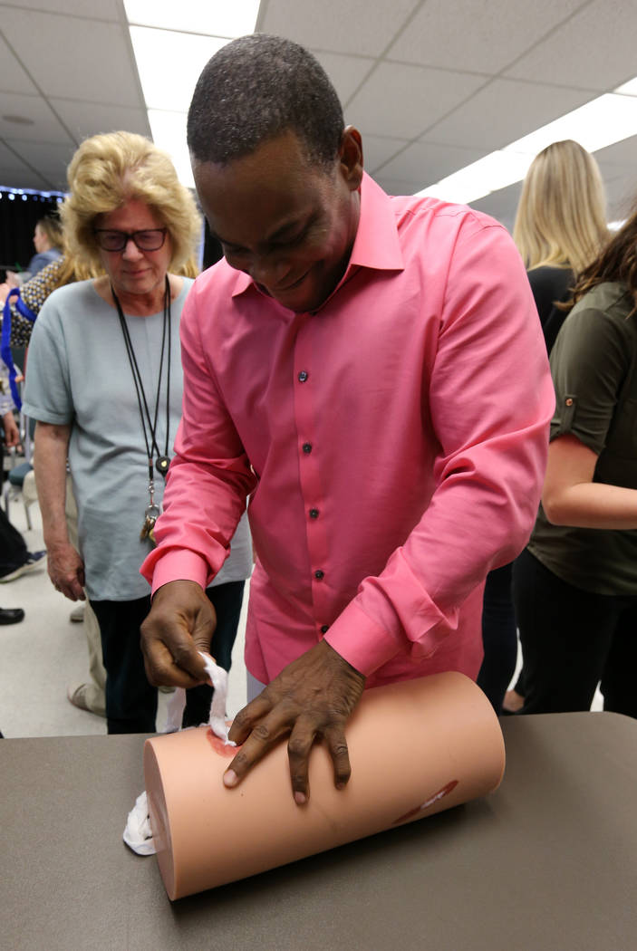 "Las Vegas Academy counselor for film and video, liberal arts and mariachi and recruiting counselor Darren Jacobs learns how to stuff a wound during University Medical Center ""Stop the Bleed&q ..."