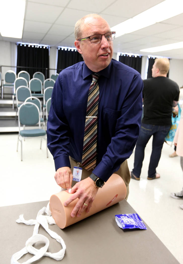 "Las Vegas Academy Assistant Principal Joshua Hager learns how to stuff a wound during University Medical Center ""Stop the Bleed"" training at the school Monday, April 30, 2018. K.M. Canno ..."