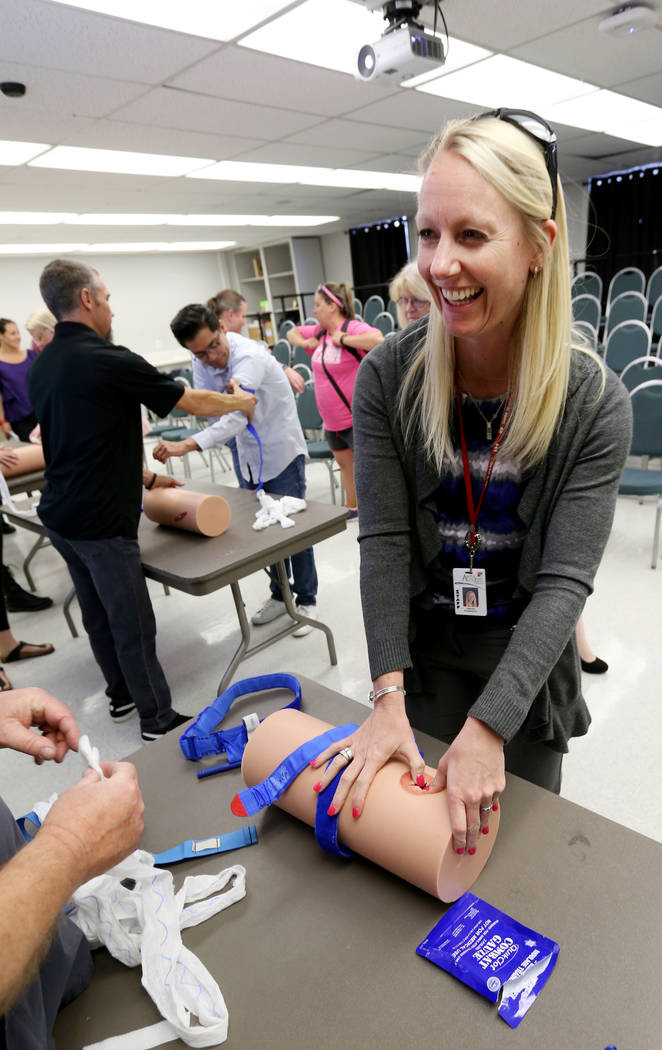 "Las Vegas Academy Dean of Students Sarah Robinson learns how to stuff a wound during University Medical Center ""Stop the Bleed"" training at the school Monday, April 30, 2018. K.M. Cannon ..."