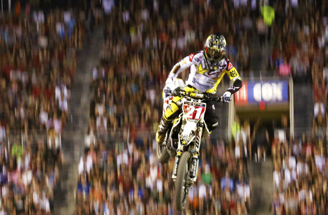 Jason Anderson (21), of New Mexico, competes in the 450SX second heat during the Monster Energy Supercross season final at Sam Boyd Stadium in Las Vegas on Saturday, May 5, 2018. He got second pla ...