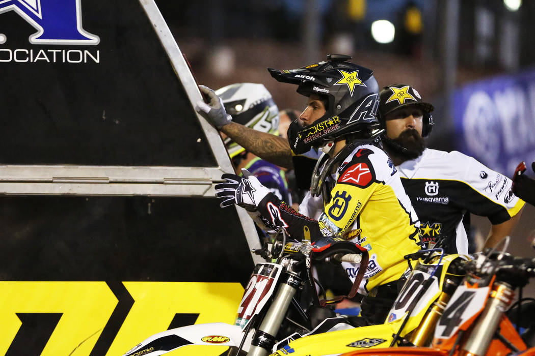 Jason Anderson (21), of New Mexico, waits to compete in the 450SX second heat during the Monster Energy Supercross season final at Sam Boyd Stadium in Las Vegas on Saturday, May 5, 2018. He got se ...