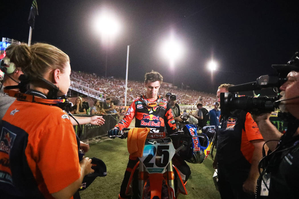 Marvin Musquin (25), of Florida, meets with his crew after winning the 450SX second heat during the Monster Energy Supercross season final at Sam Boyd Stadium in Las Vegas on Saturday, May 5, 2018 ...