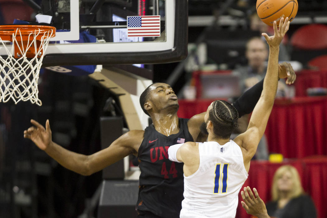 UNLV Rebels forward Brandon McCoy (44) blocks Nevada Wolf Pack forward Cody Martin (11) in the second half of the Mountain West Conference men's basketball tournament game at the Thomas & Mack ...