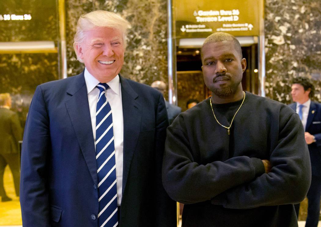 Donald Trump and Kanye West. (AP Photo/Seth Wenig, File)