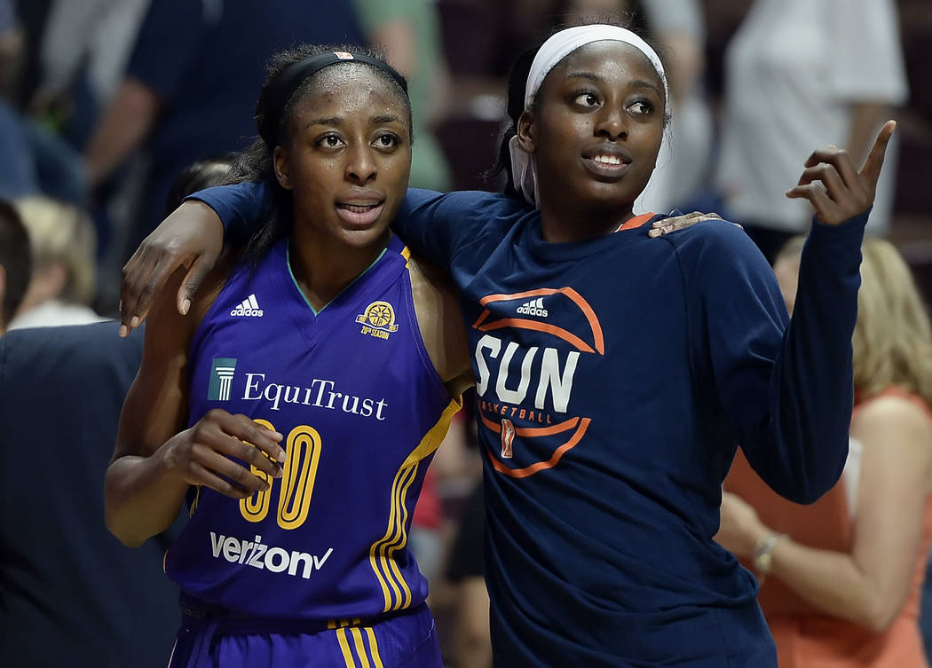 In this May 26, 2016, file photo, sisters Los Angeles Sparks' Nneka Ogwumike, left, and Connecticut Sun's Chiney Ogwumike, right, walk off the court together at the end of a WNBA basketball game b ...