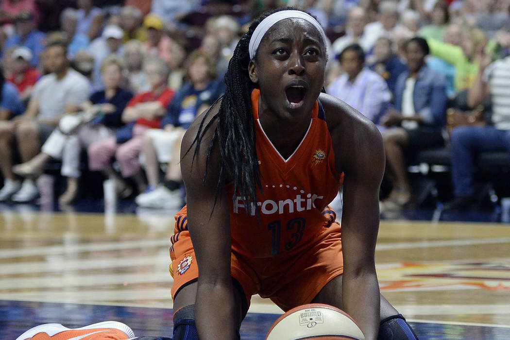 In this July 7, 2016, file photo, Connecticut Sun's Chiney Ogwumike reacts during overtime of a WNBA basketball game against the Minnesota Lynx, in Uncasville, Conn. (AP Photo/Jessica Hill, File)