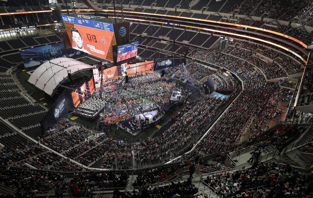In this April 26, 2018 file photo, Oklahoma's Baker Mayfield appears on the video screen after being picked by the Cleveland Browns during the first round of the NFL football draft in Arlington, T ...