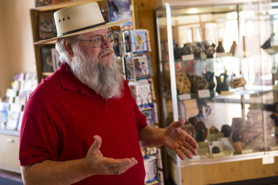 """Clark County museums administrator Mark Hall-Patton talks about the history of the Clark County Museum in Henderson on Wednesday, April 4, 2018. The museum is featuring an exhibition called """"50 Ye ..."""