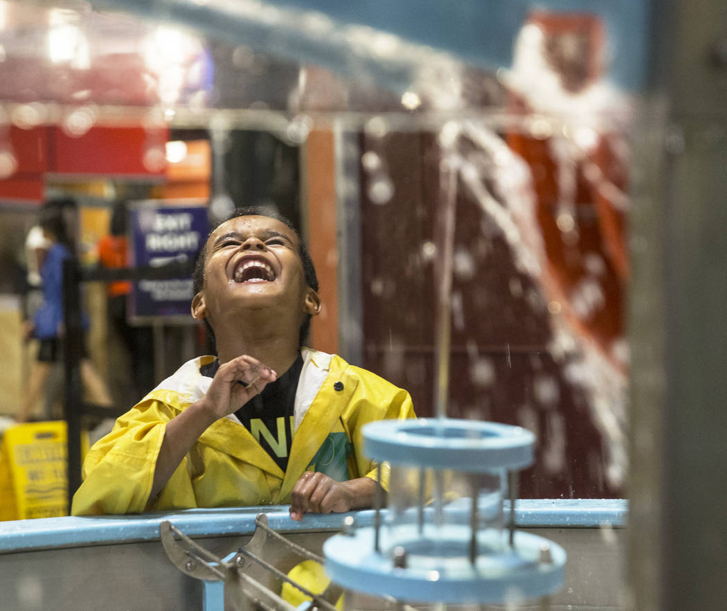 Duane Stoner III splashes around in Water World at the DISCOVERY Children's Museum on Tuesday, May 1, 2018, in Las Vegas. Benjamin Hager Las Vegas Review-Journal @benjaminhphoto