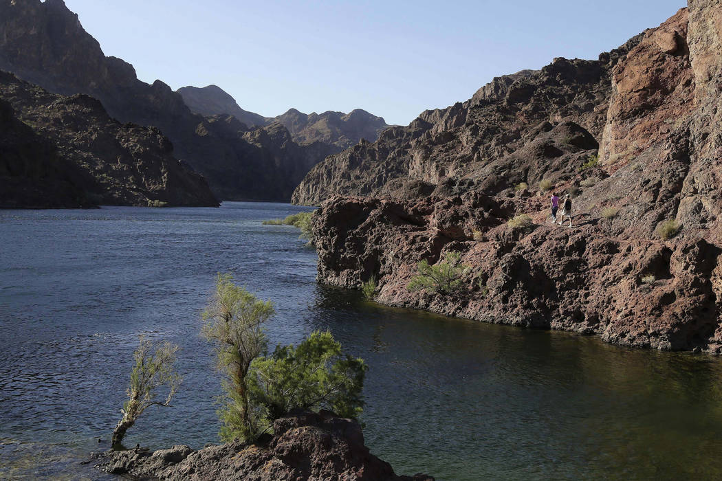 Hikers make their way along the banks of the Colorado River near Willow Beach, Ariz. on April 14, 2013. (AP Photo/Julie Jacobson, File)