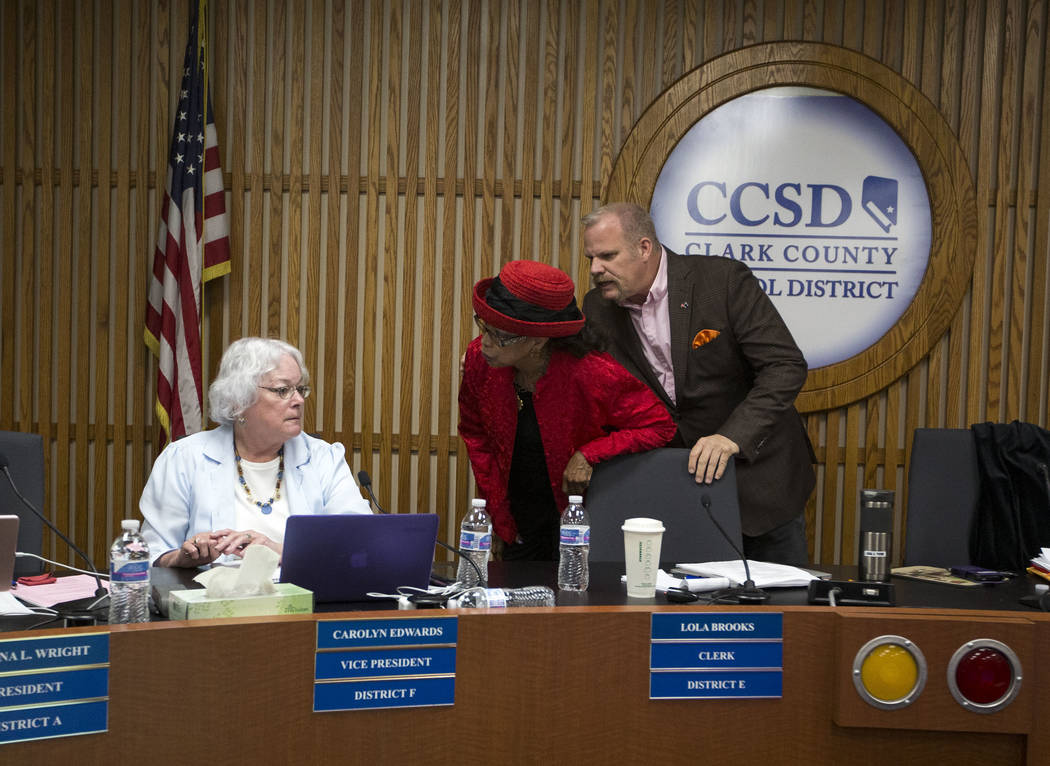 Clark County School District trustees Carolyn Edwards, left, argues with Dr. Linda E. Young as Kevin Child intervenes during a CCSD Board of Trustees meeting at CCSD's education center in Las Vega ...