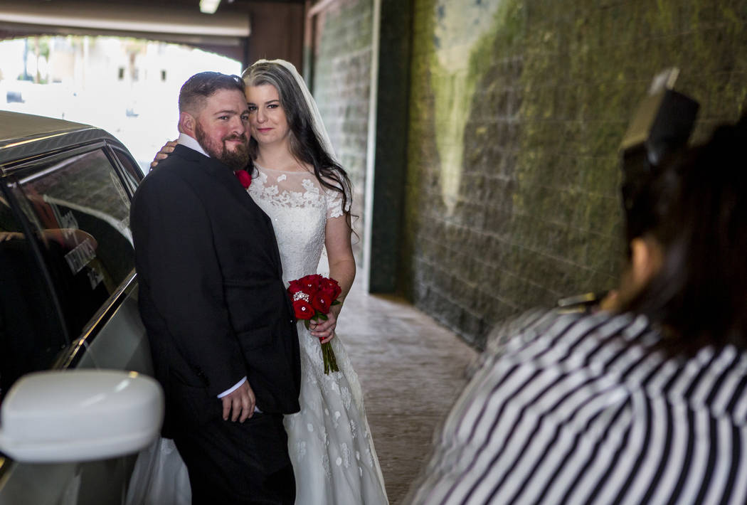 Violetta Kovacs, chapel photographer, takes photos of the newly married Chrissy Blunt-Sternthal and Jason Sternthal of Denver at Vegas Weddings in Las Vegas on Tuesday, May 1, 2018. Patrick Conno ...